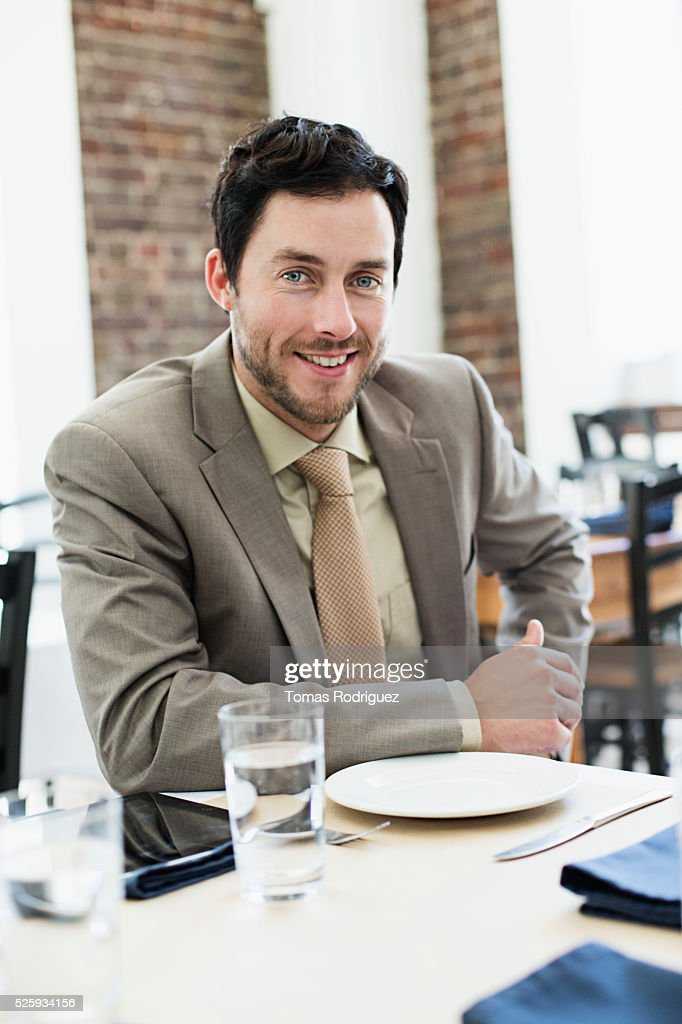 Businessman sitting in restaurant : Stock Photo