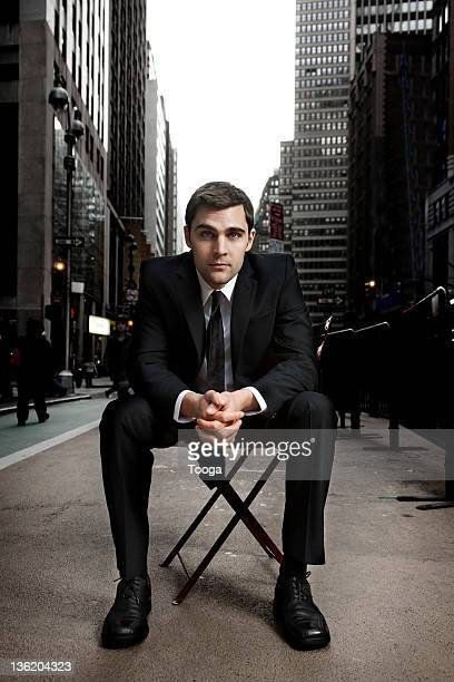 Businessman sitting in Times Square