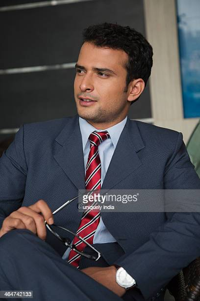 Businessman sitting on a chair and smiling
