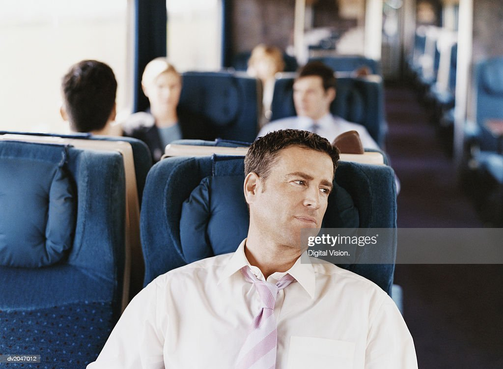 Businessman Sitting on a Passenger Train : Stock Photo