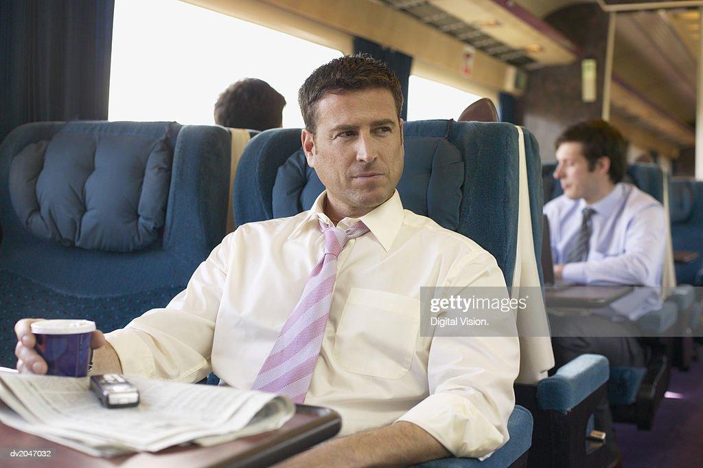 Businessman Sitting on a Passenger Train : Stock Photo