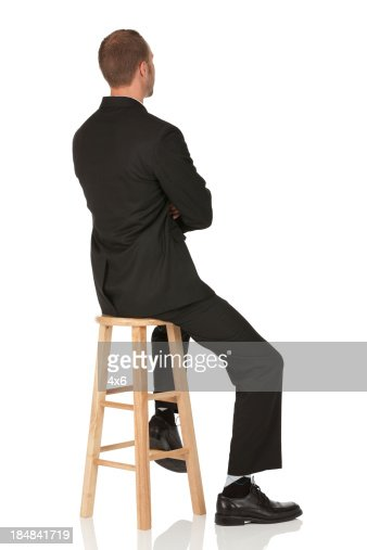 Businessman Sitting On A Stool Stock Photo Getty Images