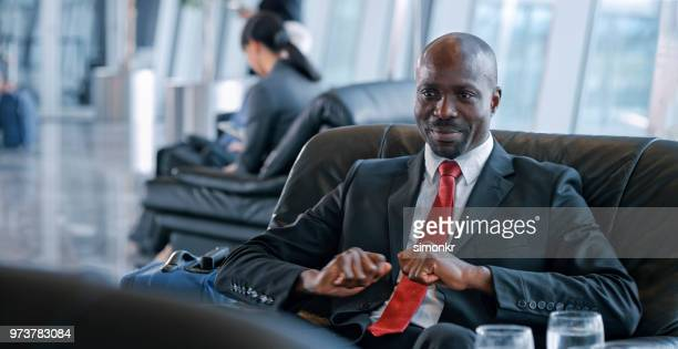 Businessman sitting on chair at airport