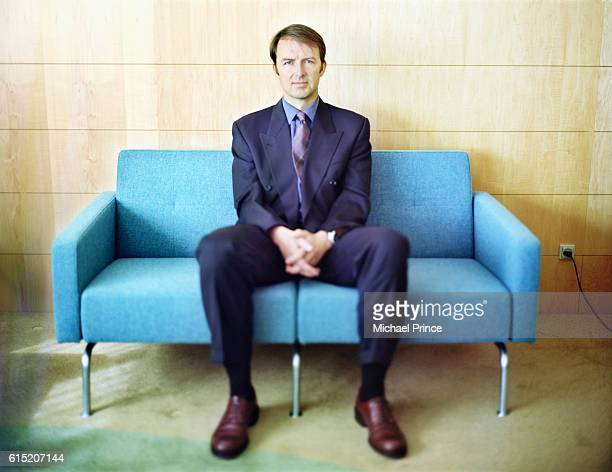 Businessman Sitting on Couch