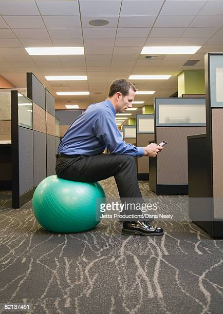 businessman sitting on exercise ball - fitness ball stock pictures, royalty-free photos & images