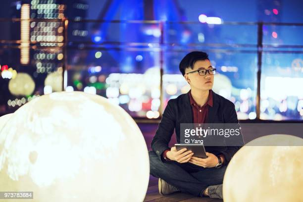 businessman sitting on the ground - lujiazui stock photos and pictures