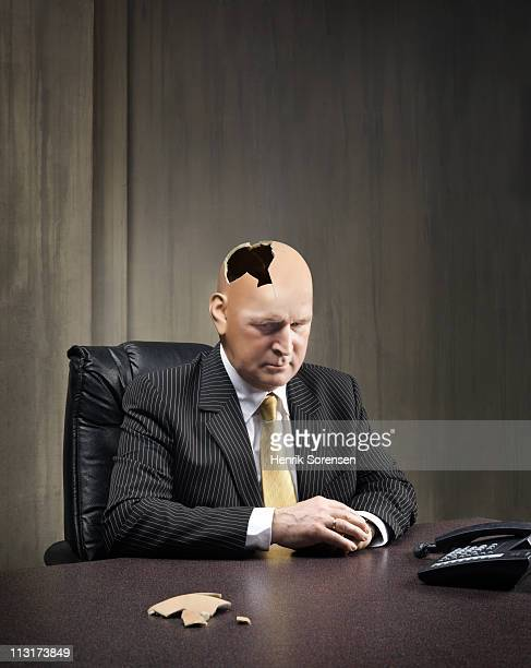 Businessman sitting with damaged head