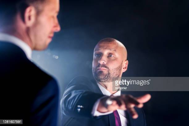businessman slapping his colleague - slapping stock pictures, royalty-free photos & images