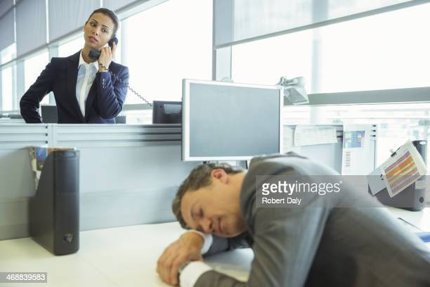 Businessman sleeping at desk in office