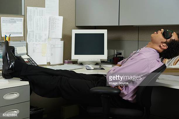 Businessman sleeping at his desk