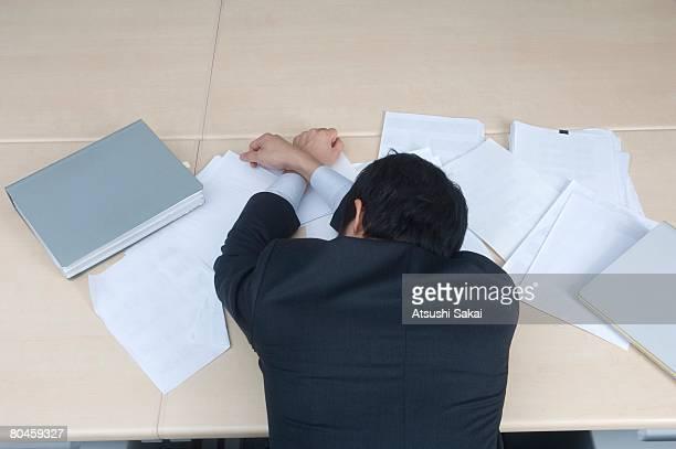 Businessman sleeping at office desk