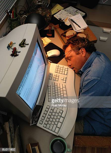 Businessman Sleeping by His Computer