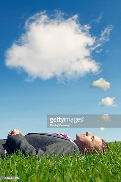 Businessman Sleeping Dreaming with Thought Bubble Clouds