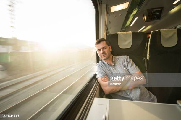 Businessman sleeping during traveling by train