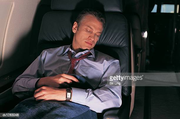Businessman Sleeping in the Cabin of a Corporate Jet