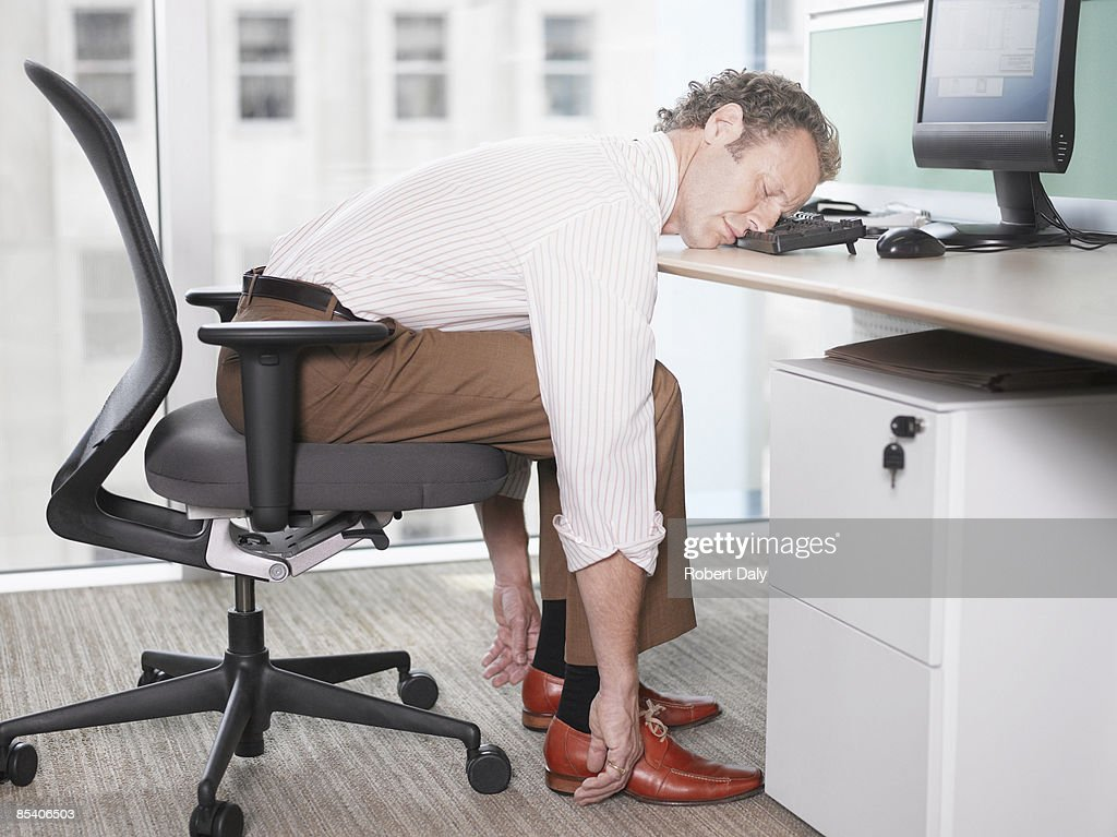 Businessman sleeping on computer keyboard : Stock Photo