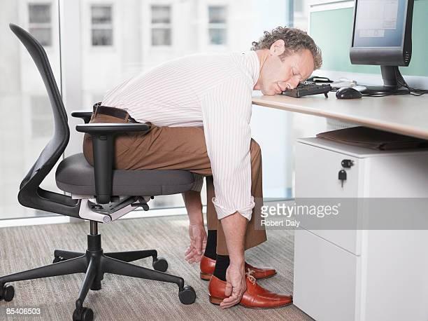 Businessman sleeping on computer keyboard
