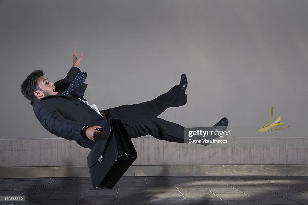 Businessman Slipping On A Banana Peel Stock Photo | Getty ...