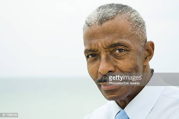 businessman smiling at camera, portrait - three quarter front view stock pictures, royalty-free photos & images