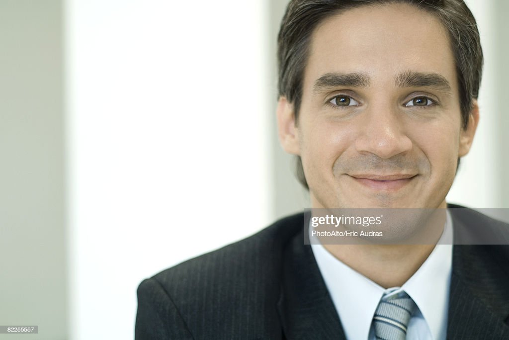 Businessman smiling at camera, portrait : Stock Photo