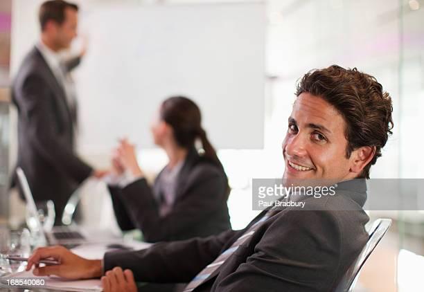 Businessman smiling at desk