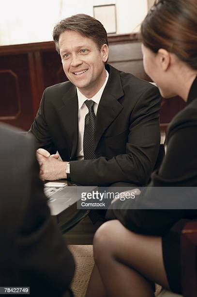 businessman smiling at others in meeting - category:cs1_maint:_others stock pictures, royalty-free photos & images