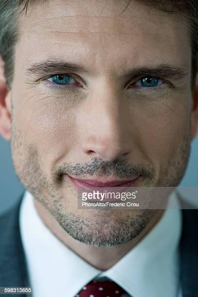 Businessman smiling, close-up portrait