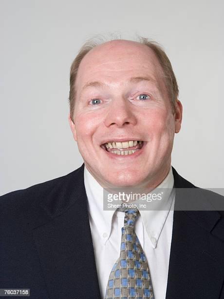 businessman smiling, close-up, portrait - hombre feo fotografías e imágenes de stock