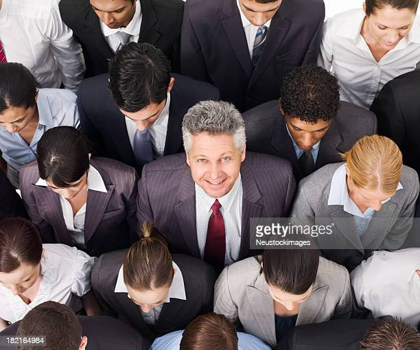 Businessman Smiling in a Crowd
