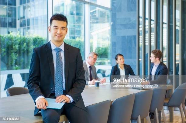 Businessman smiling in office meeting