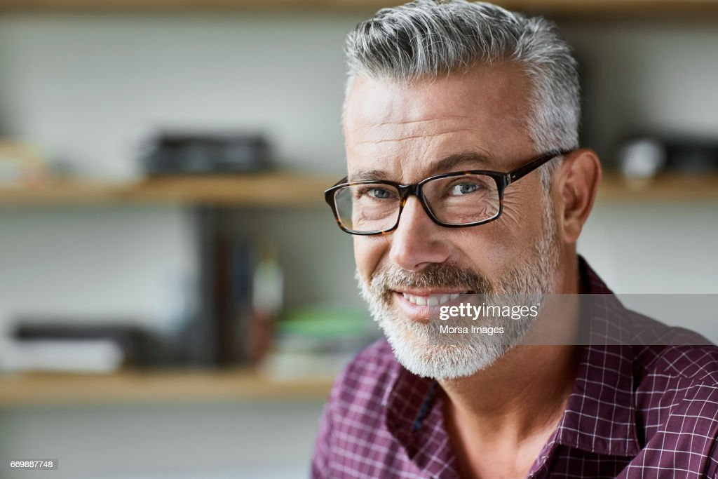 Businessman smiling in textile factory : Stock Photo