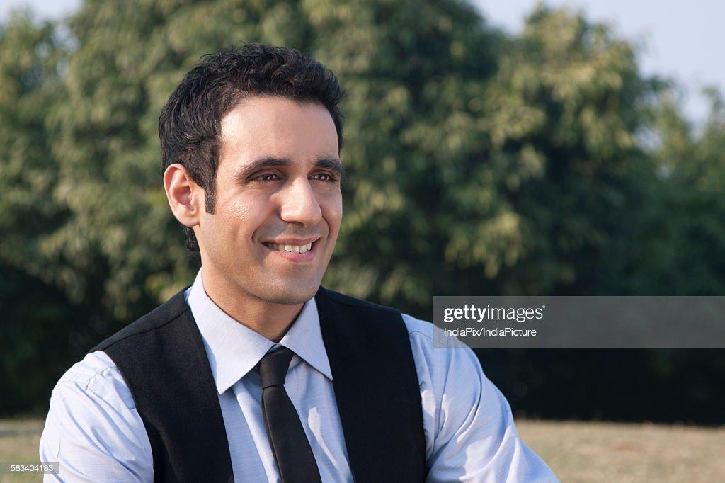 Businessman smiling , INDIA , DELHI : Stock Photo