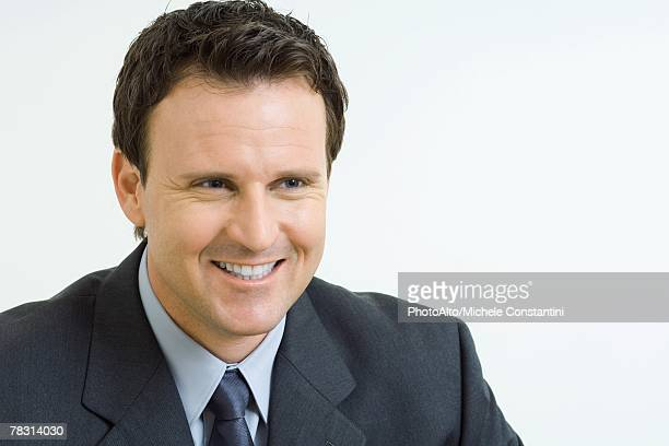 Businessman smiling, looking away, portrait