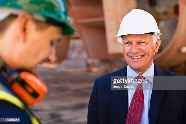 Businessman smiling on dry dock