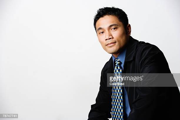 Businessman smiling, portrait, close-up