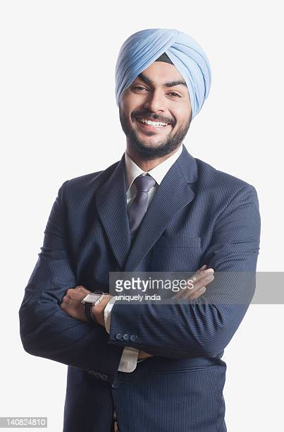businessman smiling with arms crossed - punjab india stock pictures, royalty-free photos & images