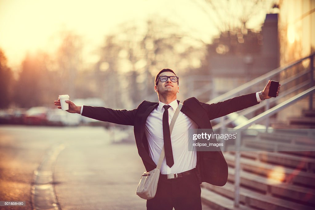 Businessman smiling with arms outstretched : Stock Photo