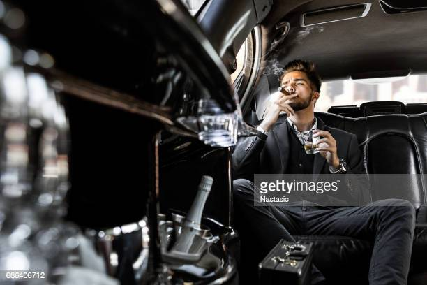 Businessman smoking and drinking