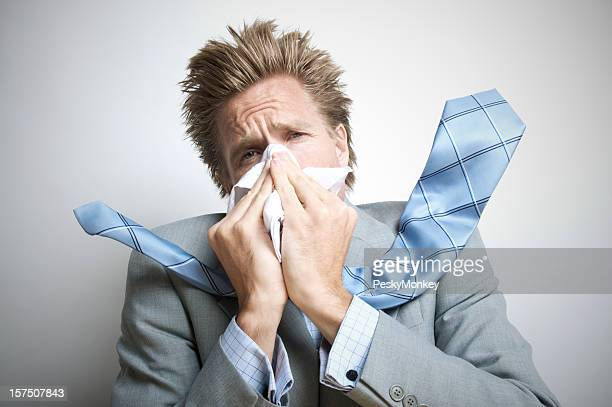 Businessman Sneezing Hard Enough for Tie to Go Flying
