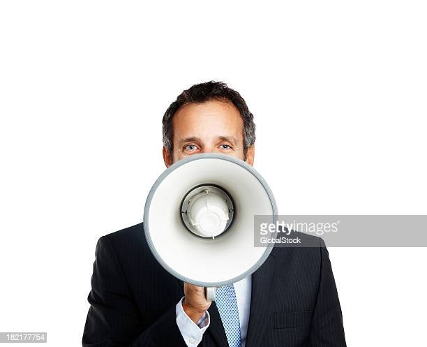 Businessman speaking in megaphone