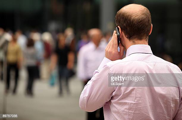 A businessman speaks on the phone in London's financial district on August 12 2009 in London England The Financial Services Authority have today...