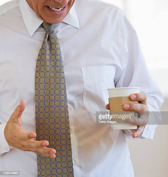businessman spilling coffee on shirt - dump stock photos and pictures