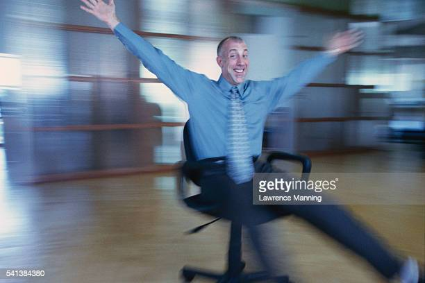 Businessman Spinning in Chair