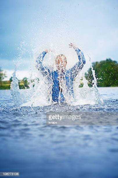 Businessman splashing a lot of water in the lake