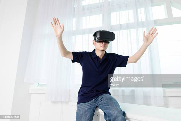 Businessman spreading arms with VR
