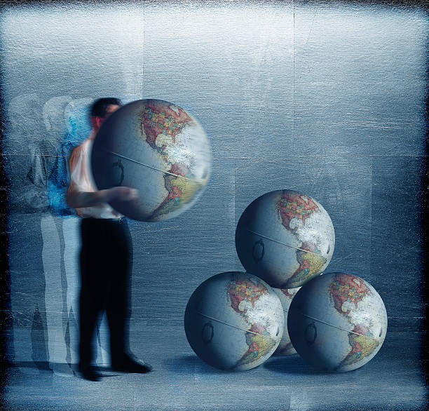 Businessman Stacking World Globes