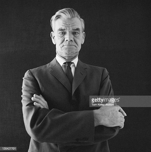 businessman standing against black background, portrait - full suit stock pictures, royalty-free photos & images
