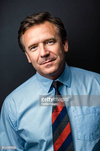 Businessman standing against colored background