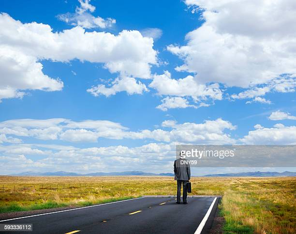 businessman standing at end of the road - finale foto e immagini stock