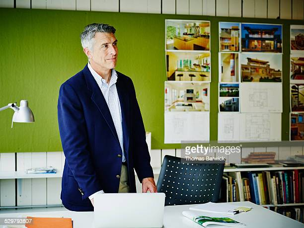 Businessman standing at workstation in office